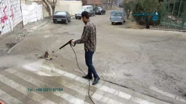 استفاده از واترجت برای شستشوی ورودی بانک  - floor cleaning by pressure washer