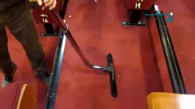 نظافت راهروها و صندلی های سینما با مکنده  - Cleaning aisles and seats cinema with vacuum cleaner