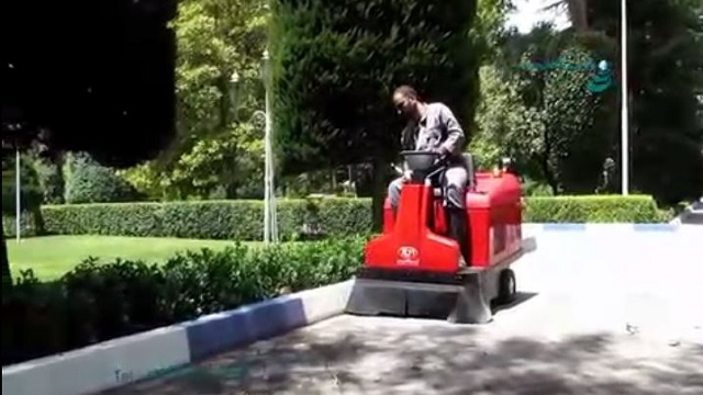 نظافت محوطه پارک با سوییپر  - use a ride on sweeper for cleaning the floor in the park